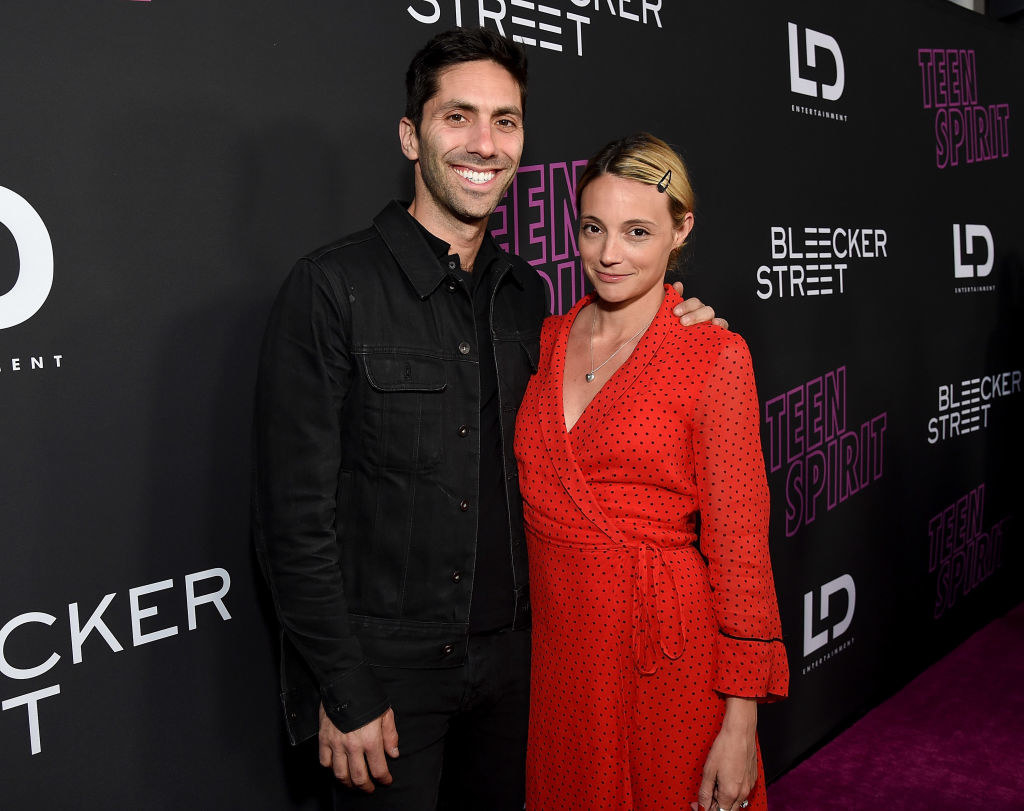 Nev Schulman and Laura Perlongo smiling on the red carpet