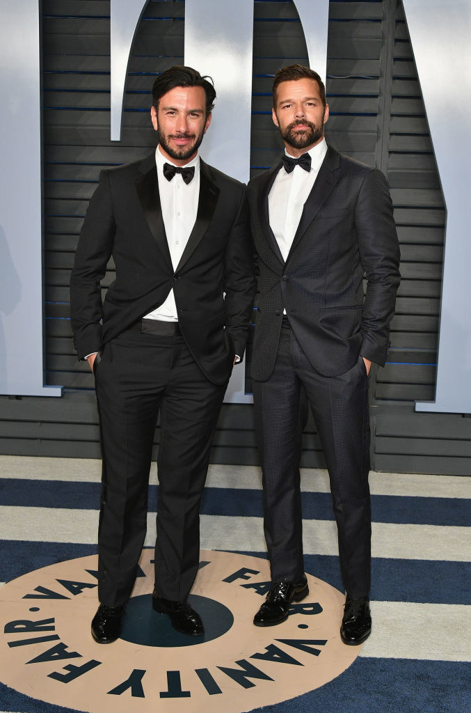 Jwan Yosef andRicky Martin in bow ties and hands in pocket, standing together
