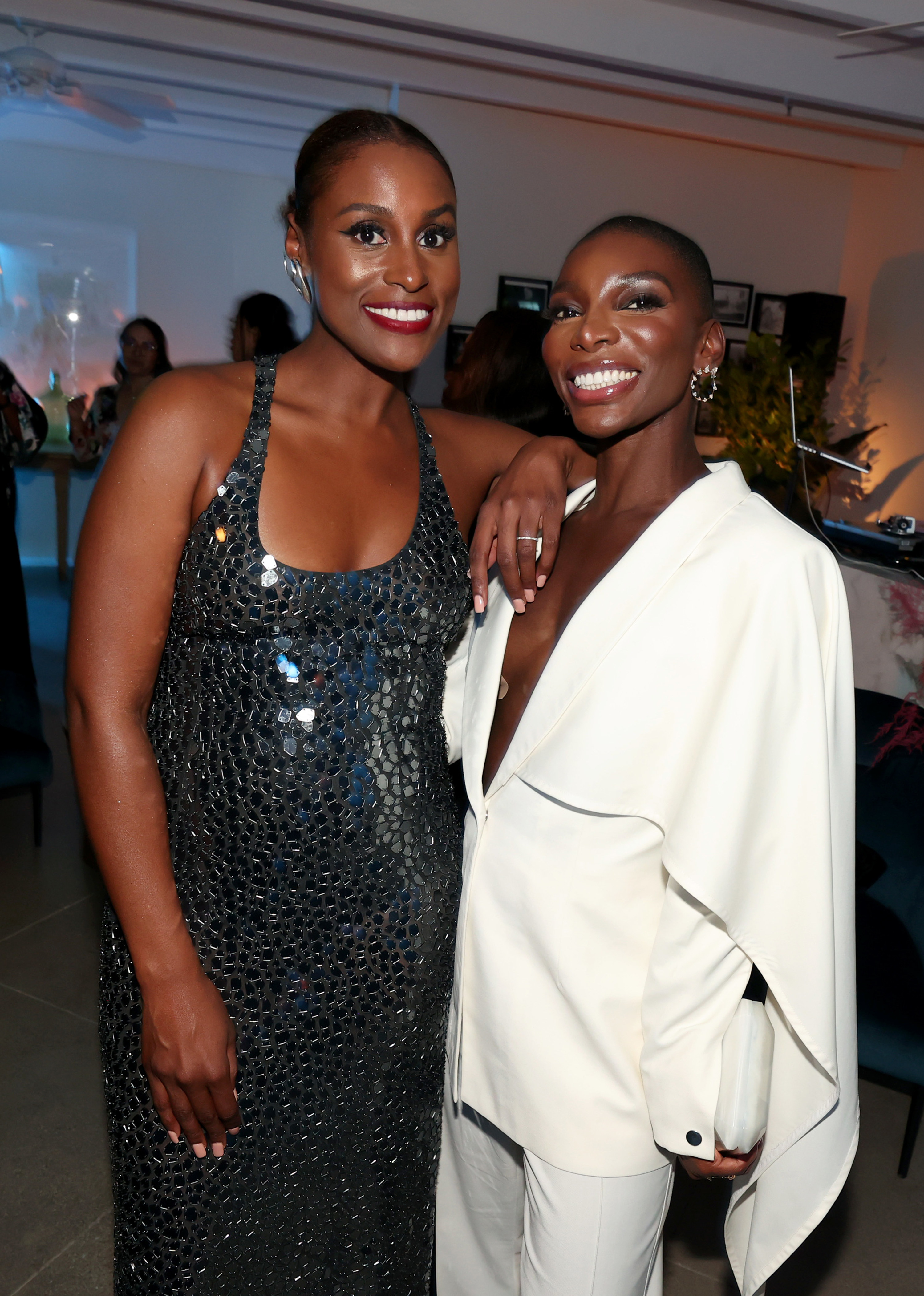 Issa Rae and Michaela standing and smiling at an event