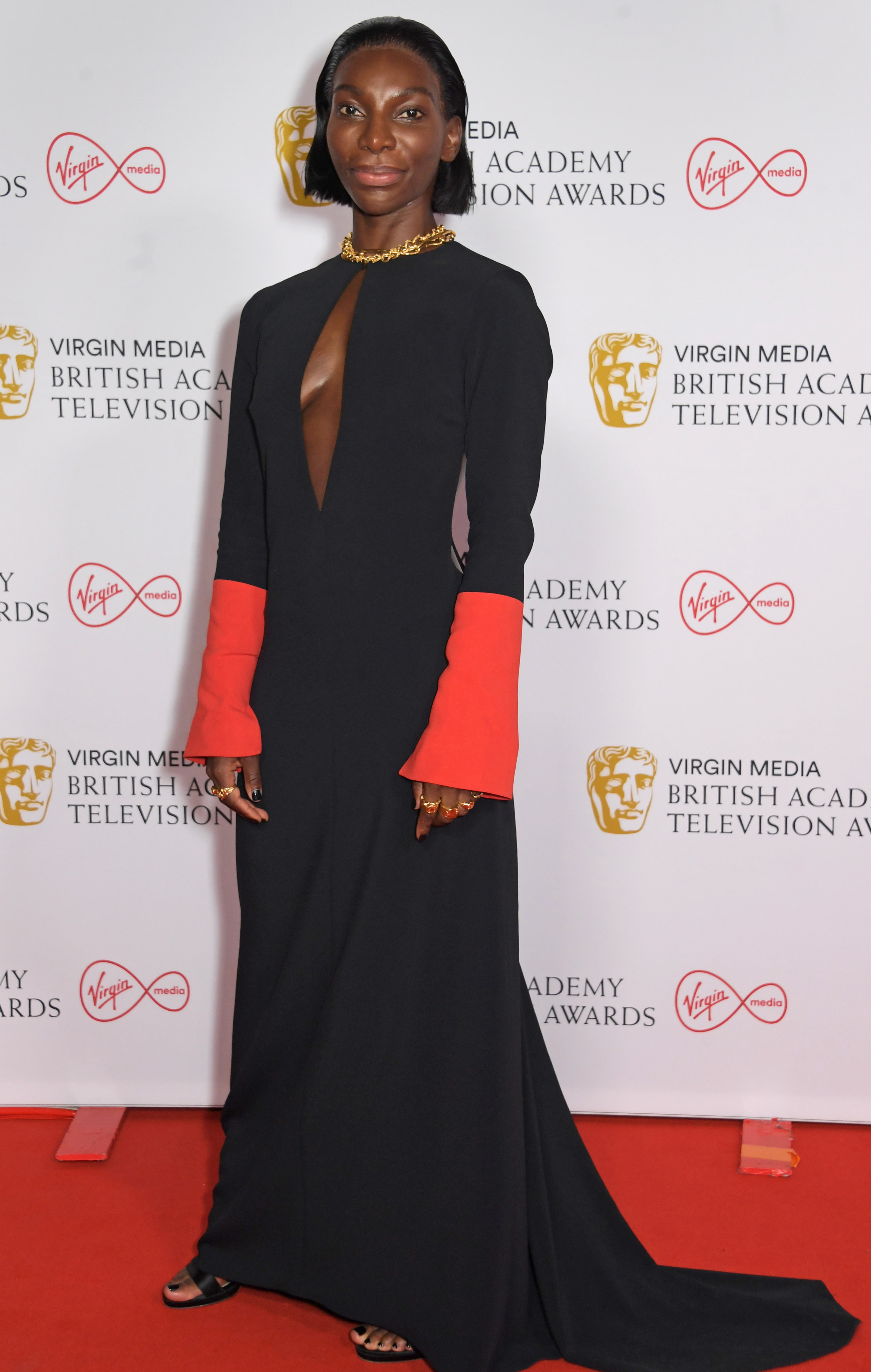 Michaela on the BAFTAs red carpet in a two-toned dress