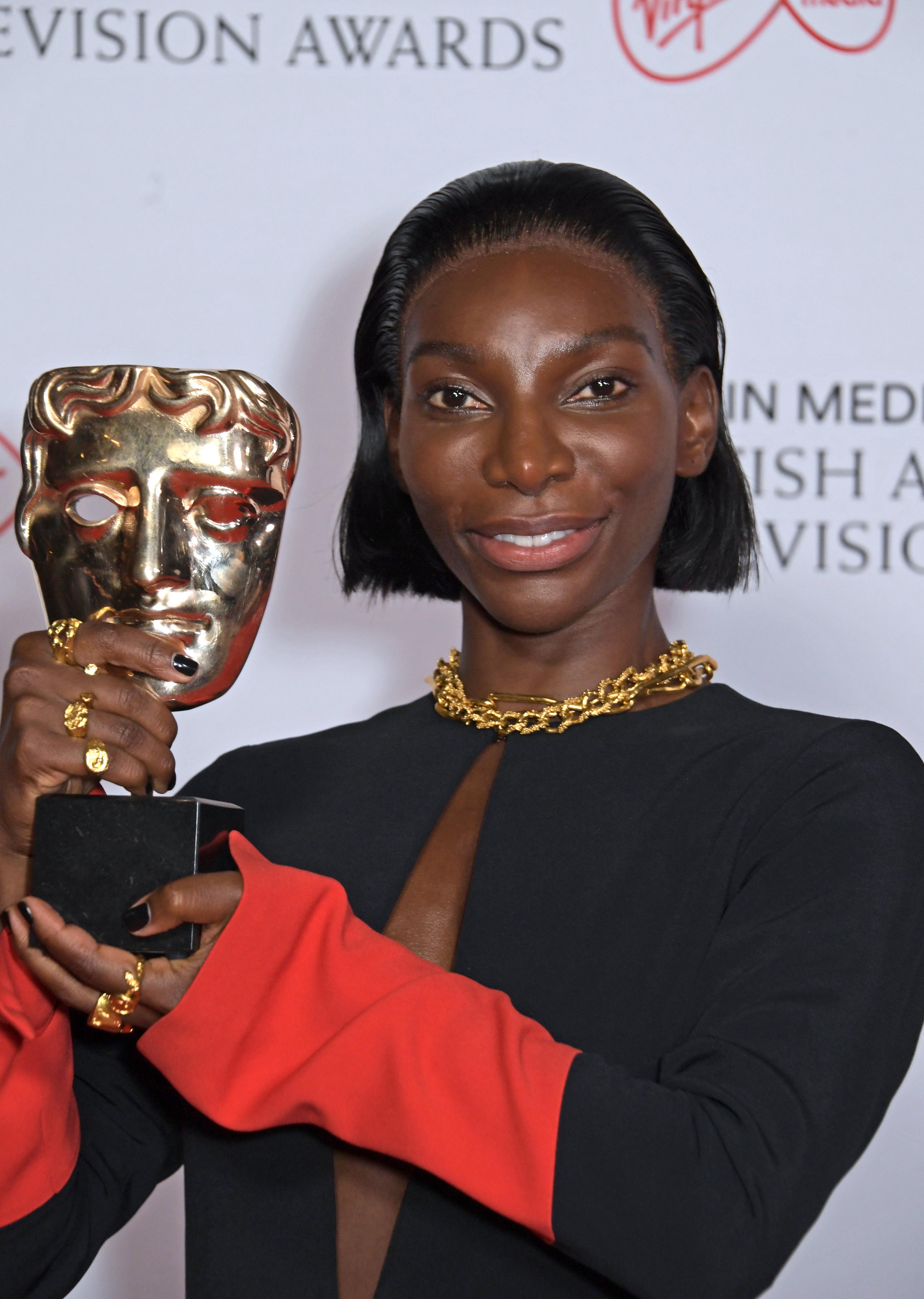 Michaela holding up an award