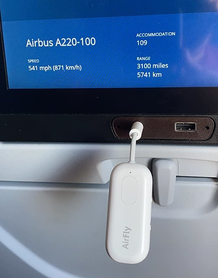 the small device plugged into an airplane headphone port