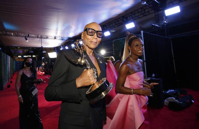 RuPaul walking with his Emmy Award