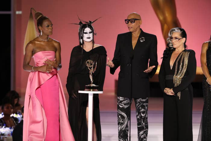 RuPaul on stage accepting the award with several members of the cast and crew