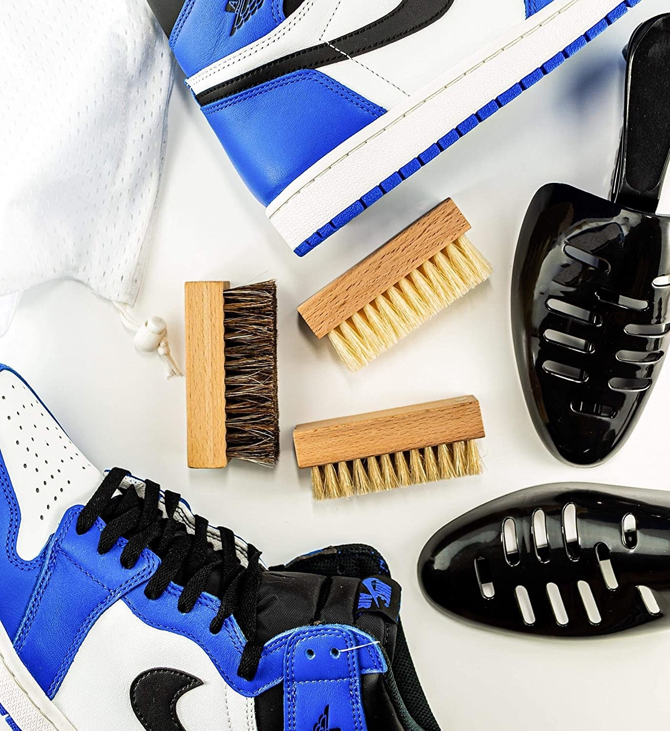 the shoe cleaning kit components and a pair of shoes