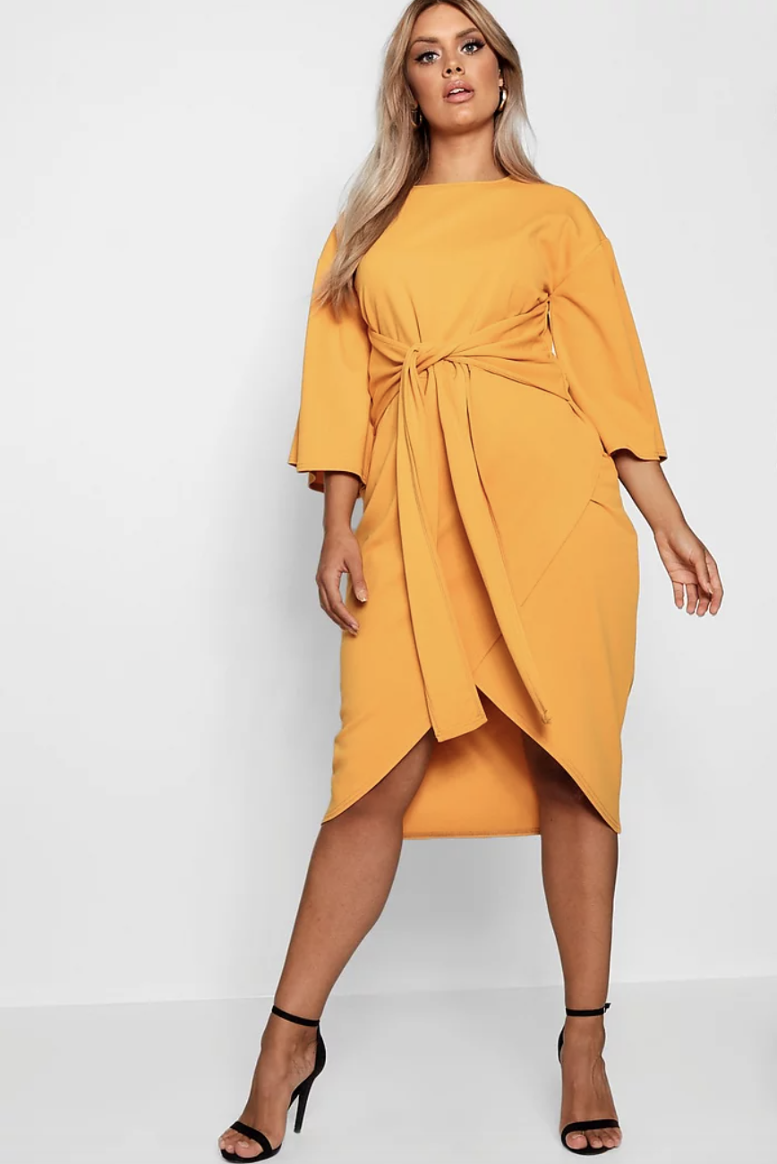 model wearing high neck dress with a wrap skirt
