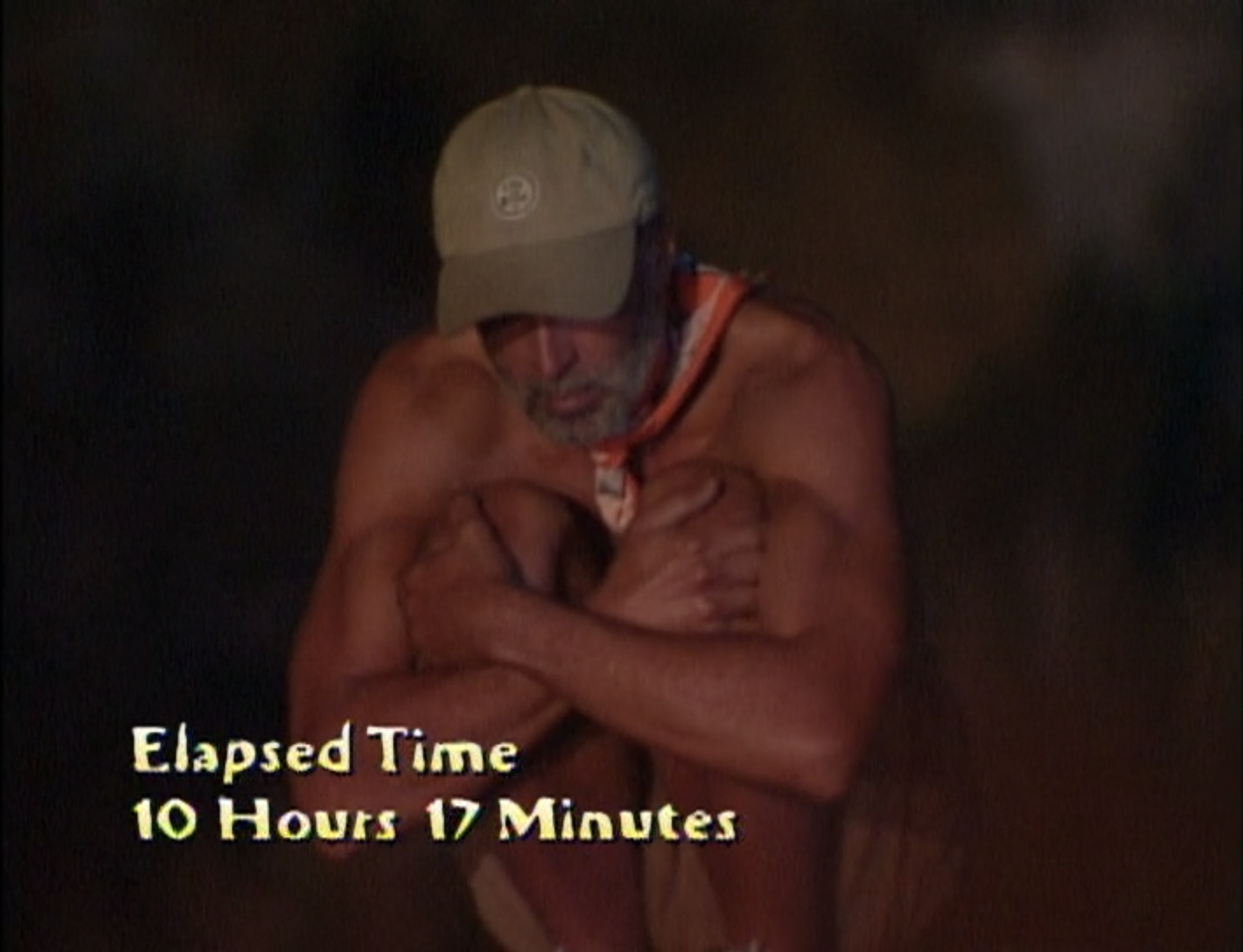 Keith Famie crouches on a pole for 10 hours and 17 minutes in Survivor: The Australian Outback