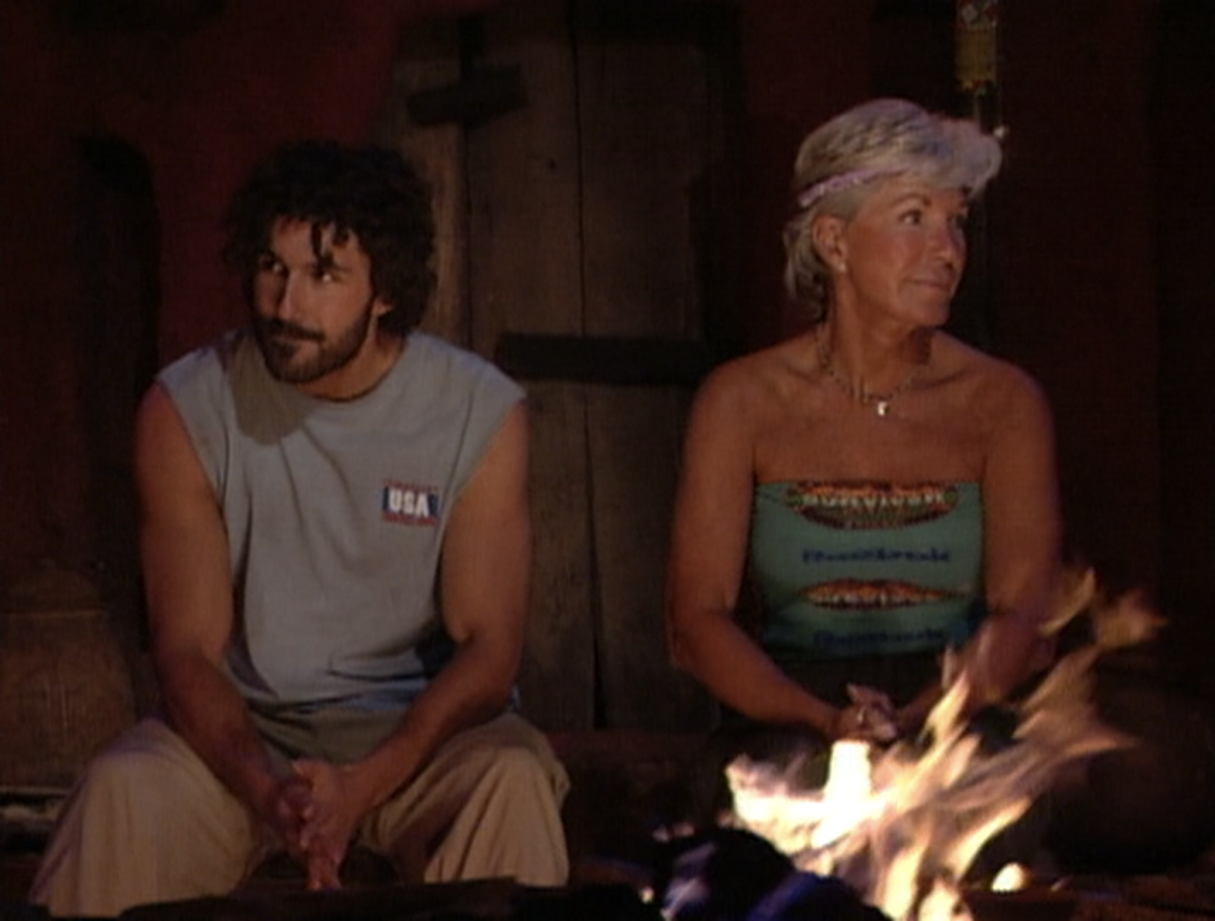 Ethan Zohn and Kim Johnson sit together at the finale of Survivor: Africa