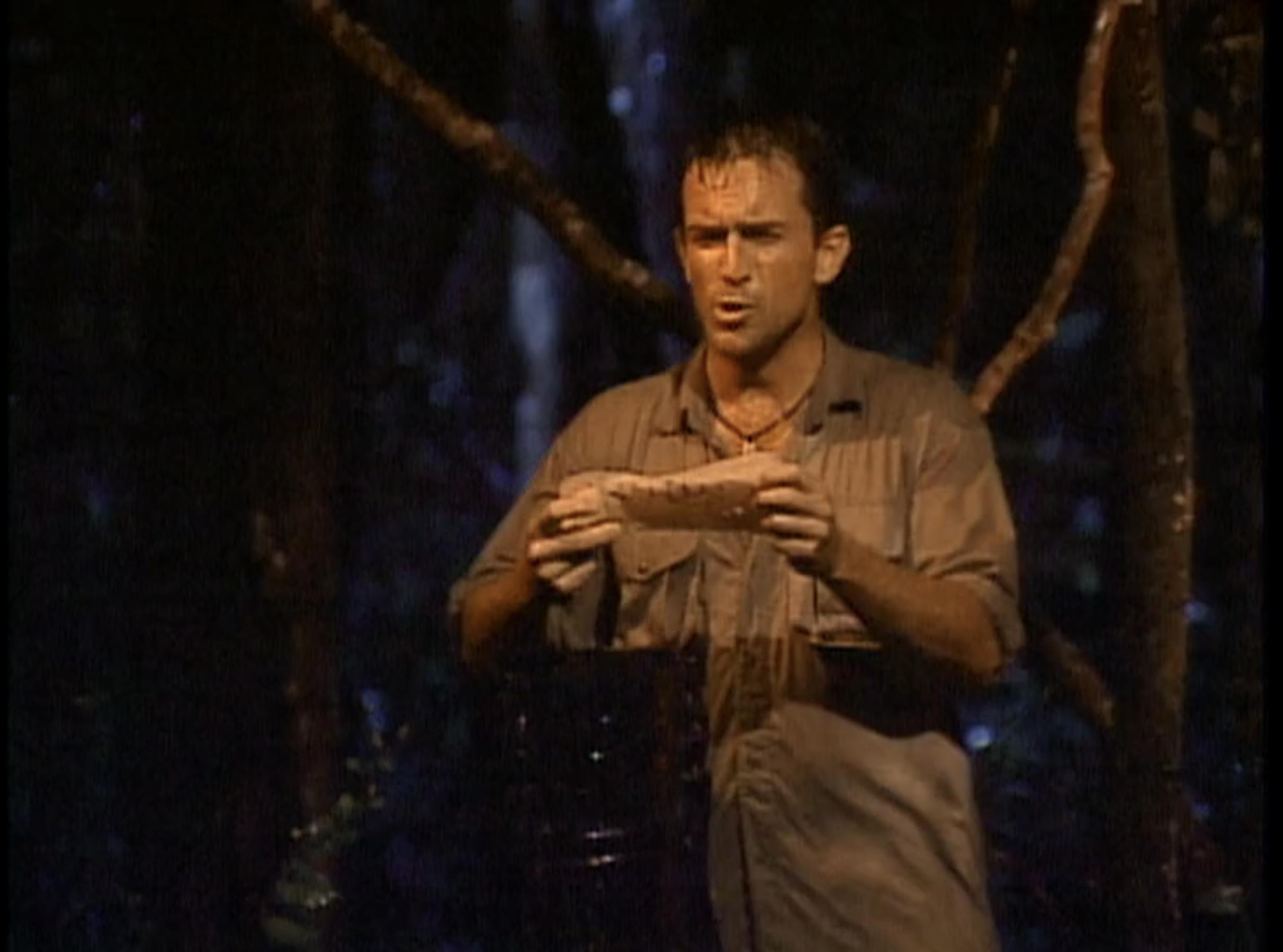 Wet Jeff Probst holds up a damp, illegible vote.