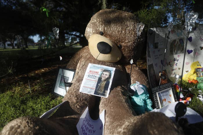 A large stuffed Teddy bear and other tributes to Gabby are laid out