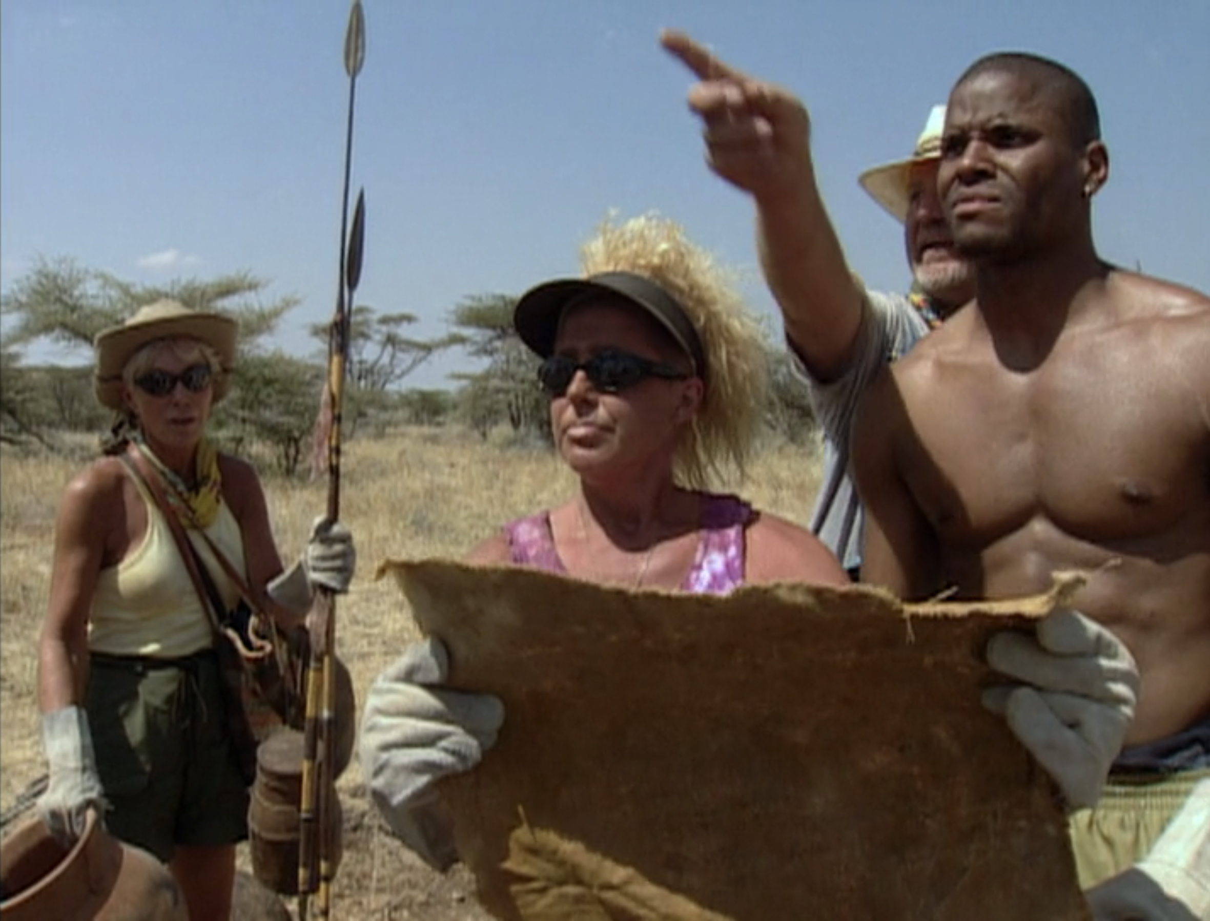 The tribe consults a map on Survivor: Africa