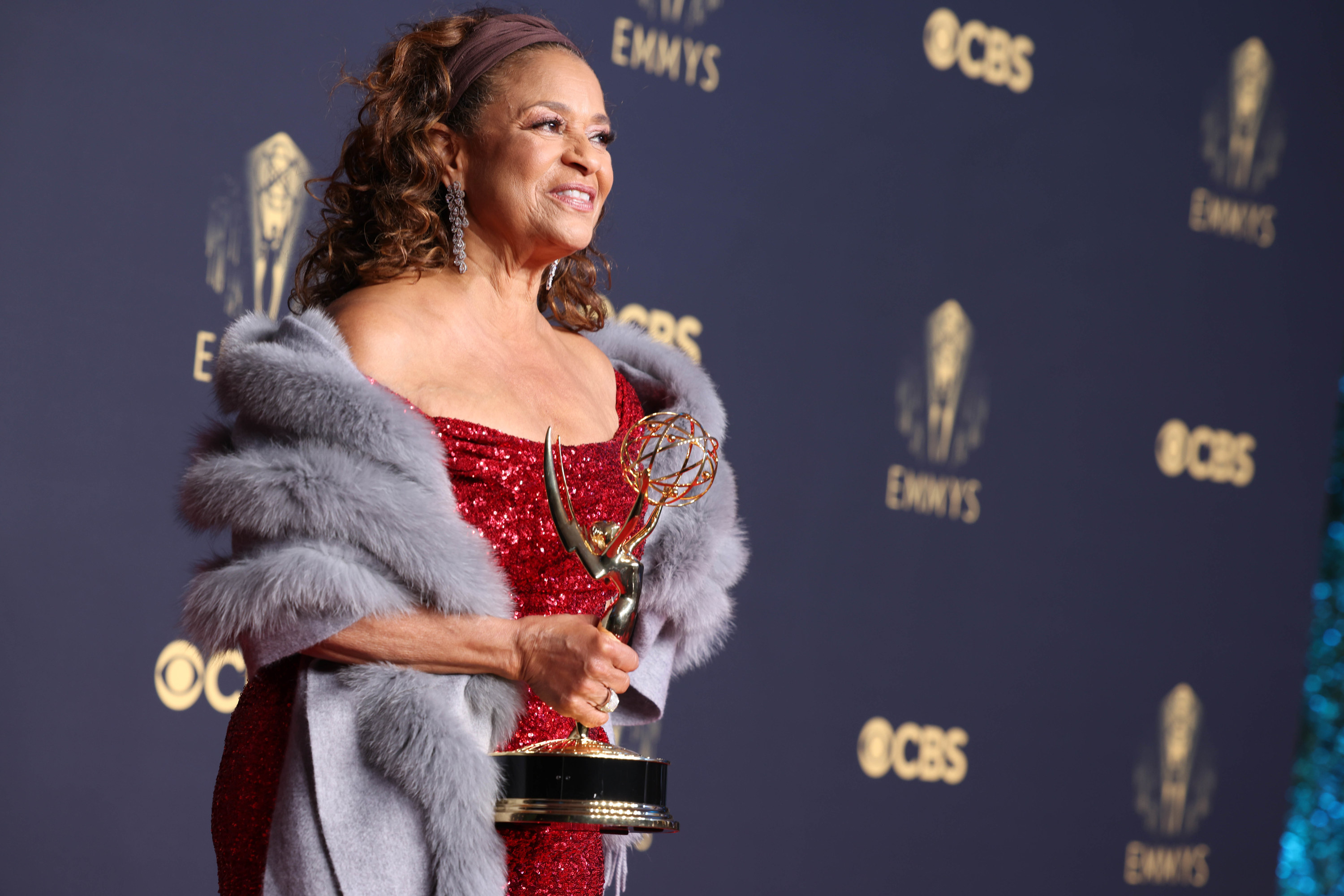 Debbie Allen at the Emmys holding the Governor's Award
