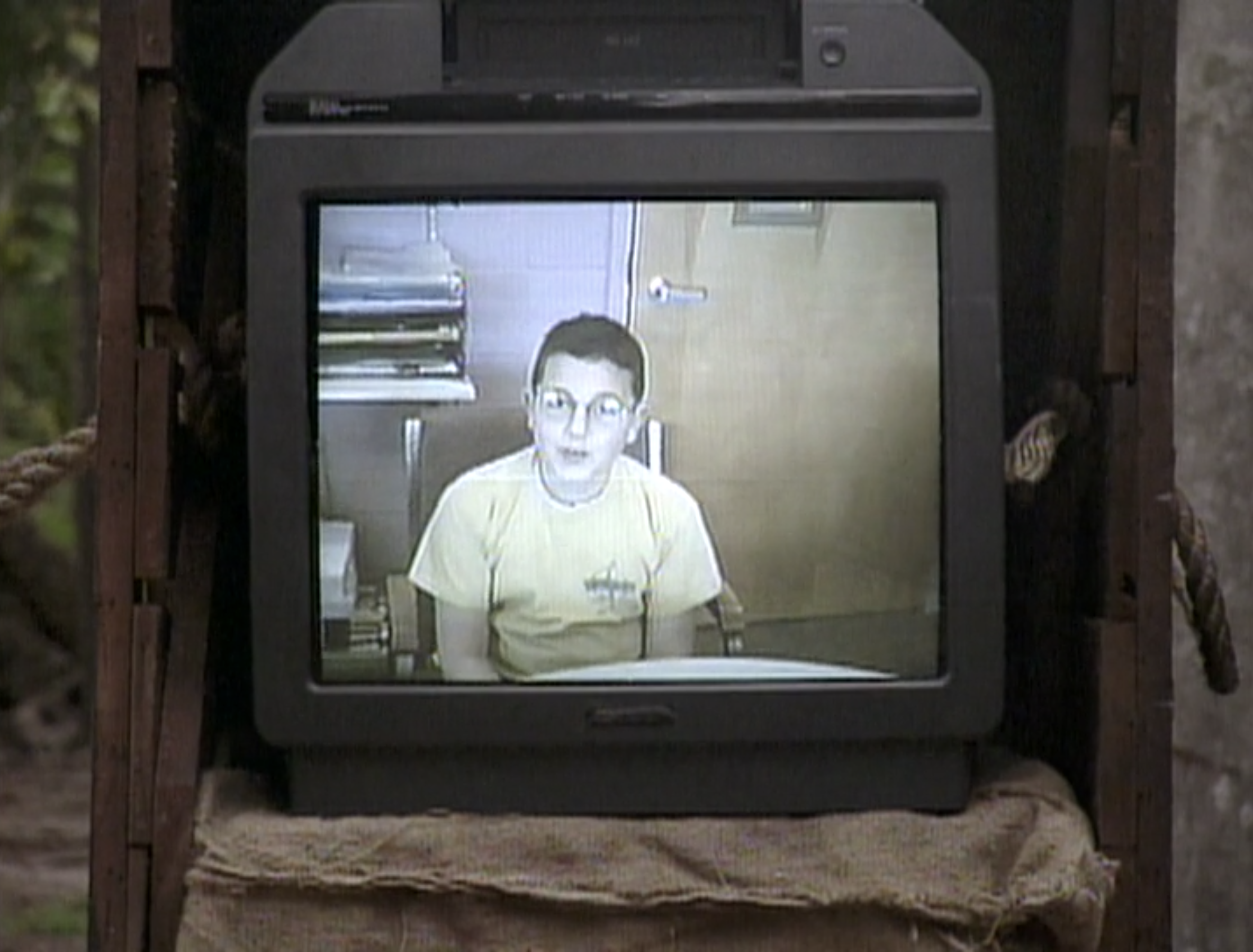 A TV playing a VHS video of a castaway's kid on Survivor: Borneo