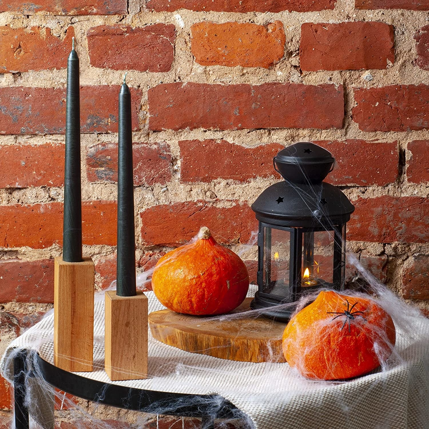 two black tapered candles