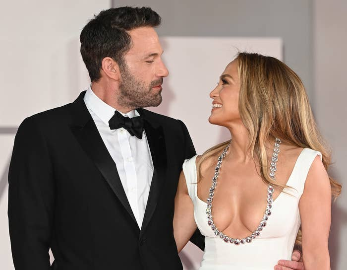 Ben and Jennifer gaze and each other with their arms around one another at a recent red carpet