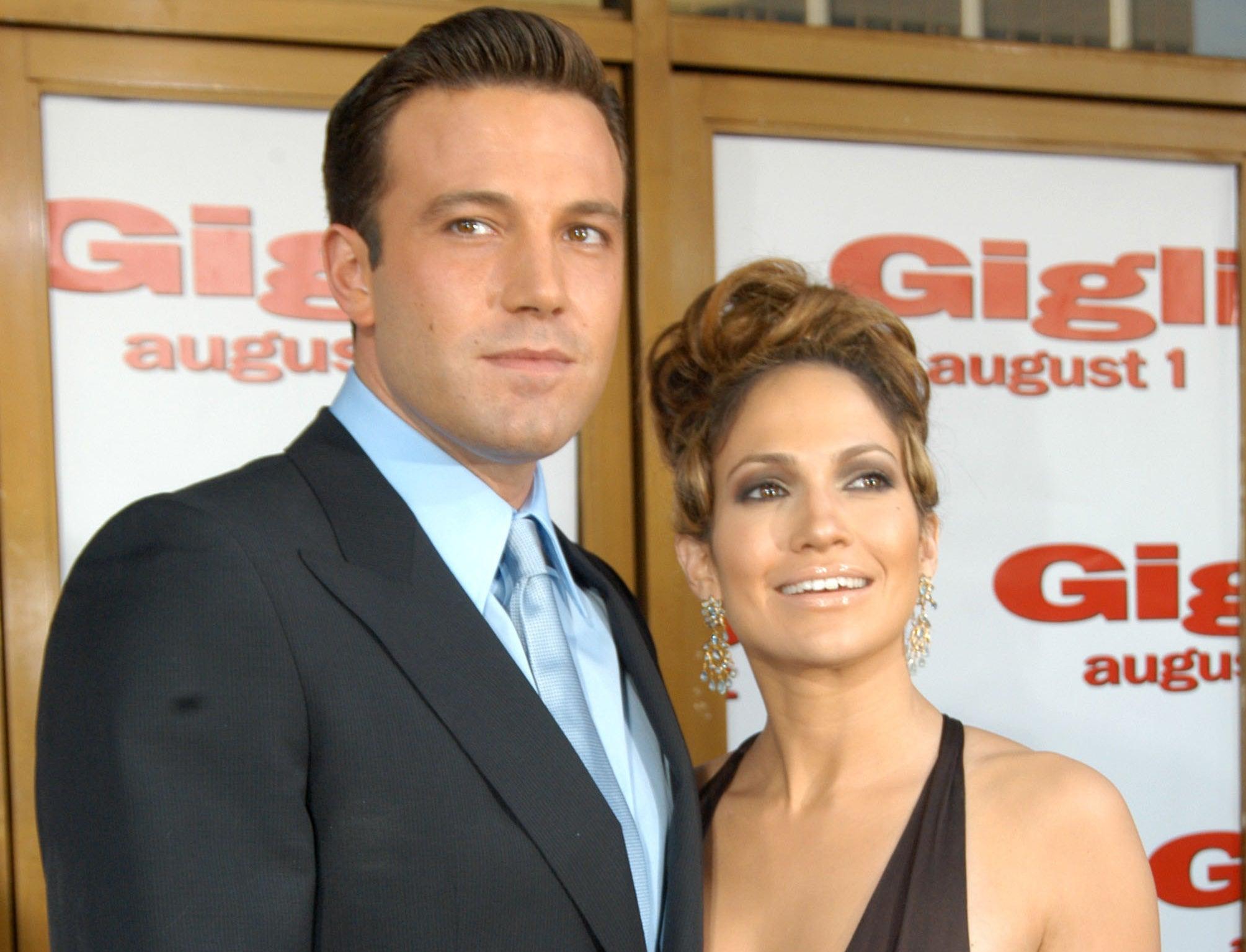 Jennifer smiles in an older photo standing next to Ben