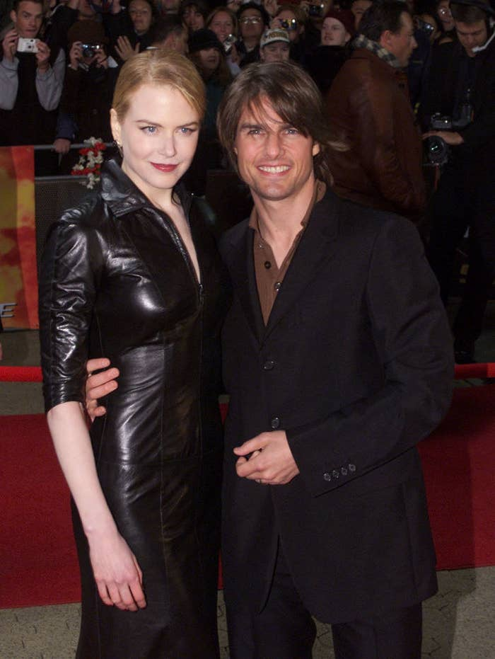 """om Cruise and his wife Nicole Kidman pose for photographers at the Sydney premiere of """"Mission Impossible 2"""""""