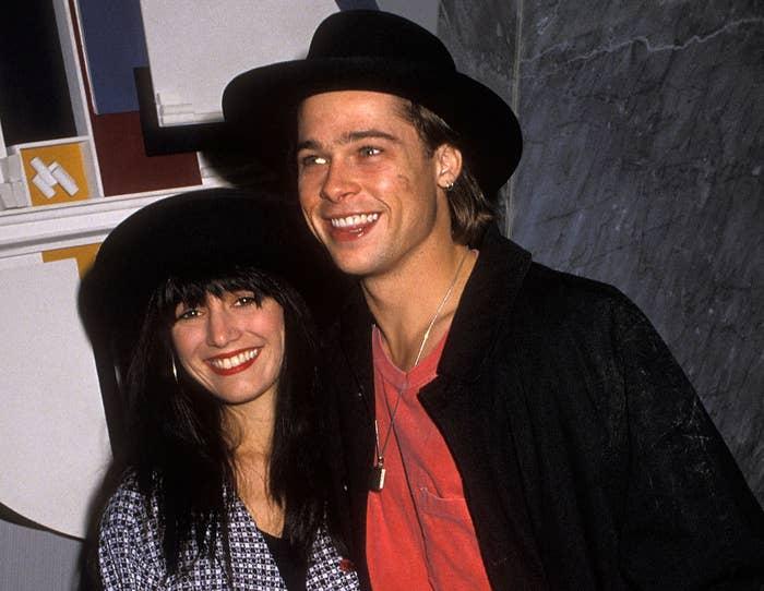 Brad and a girlfriend wear matching black hats