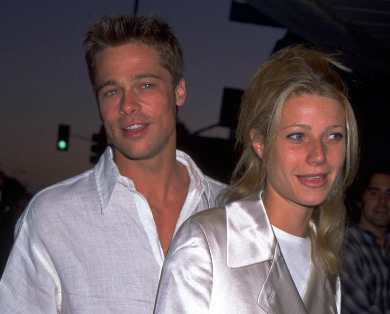 Gwyneth and Brad wear similar white button-down tops