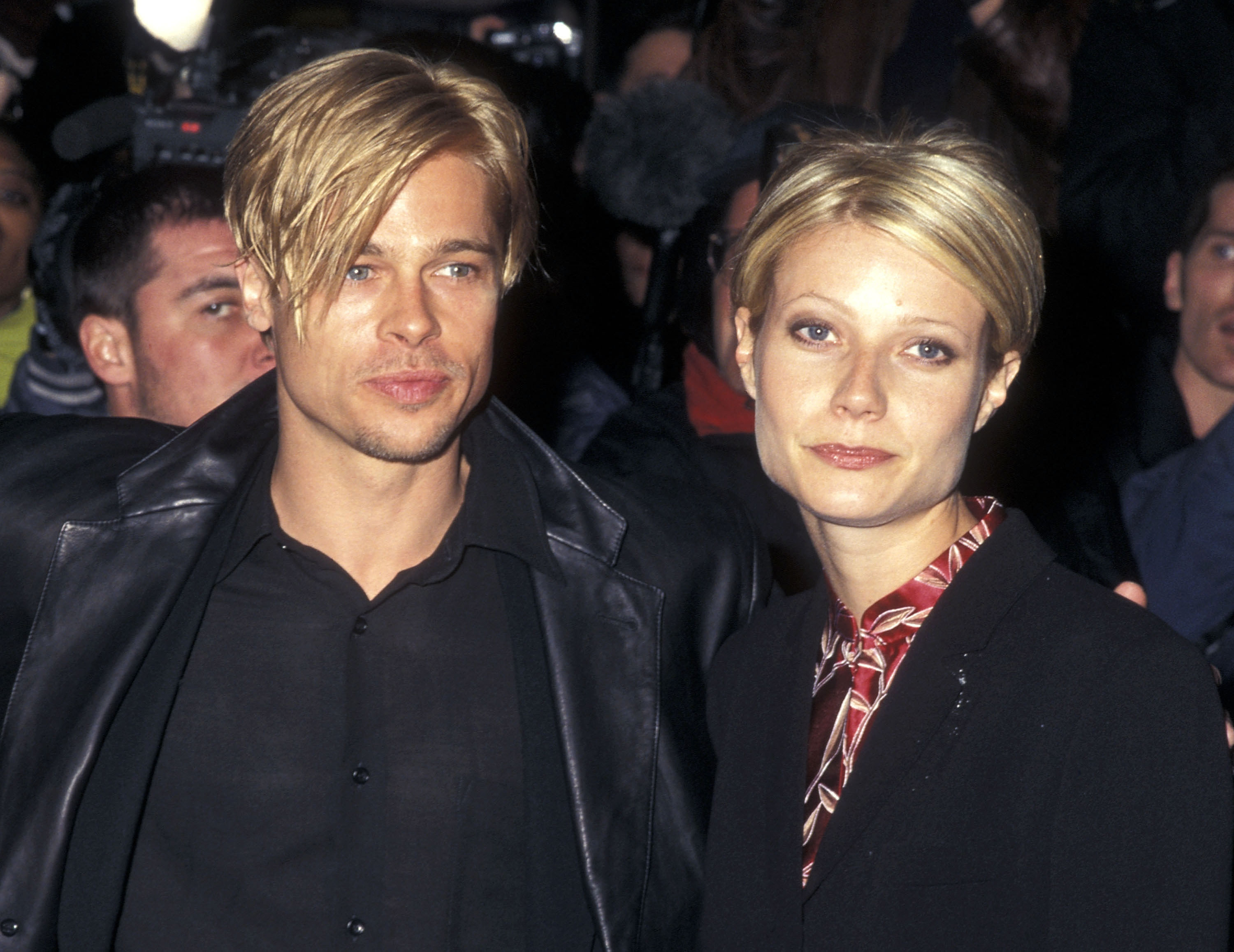 Gwyneth and Brad have the same short blonde parted to the side while wearing black blazers