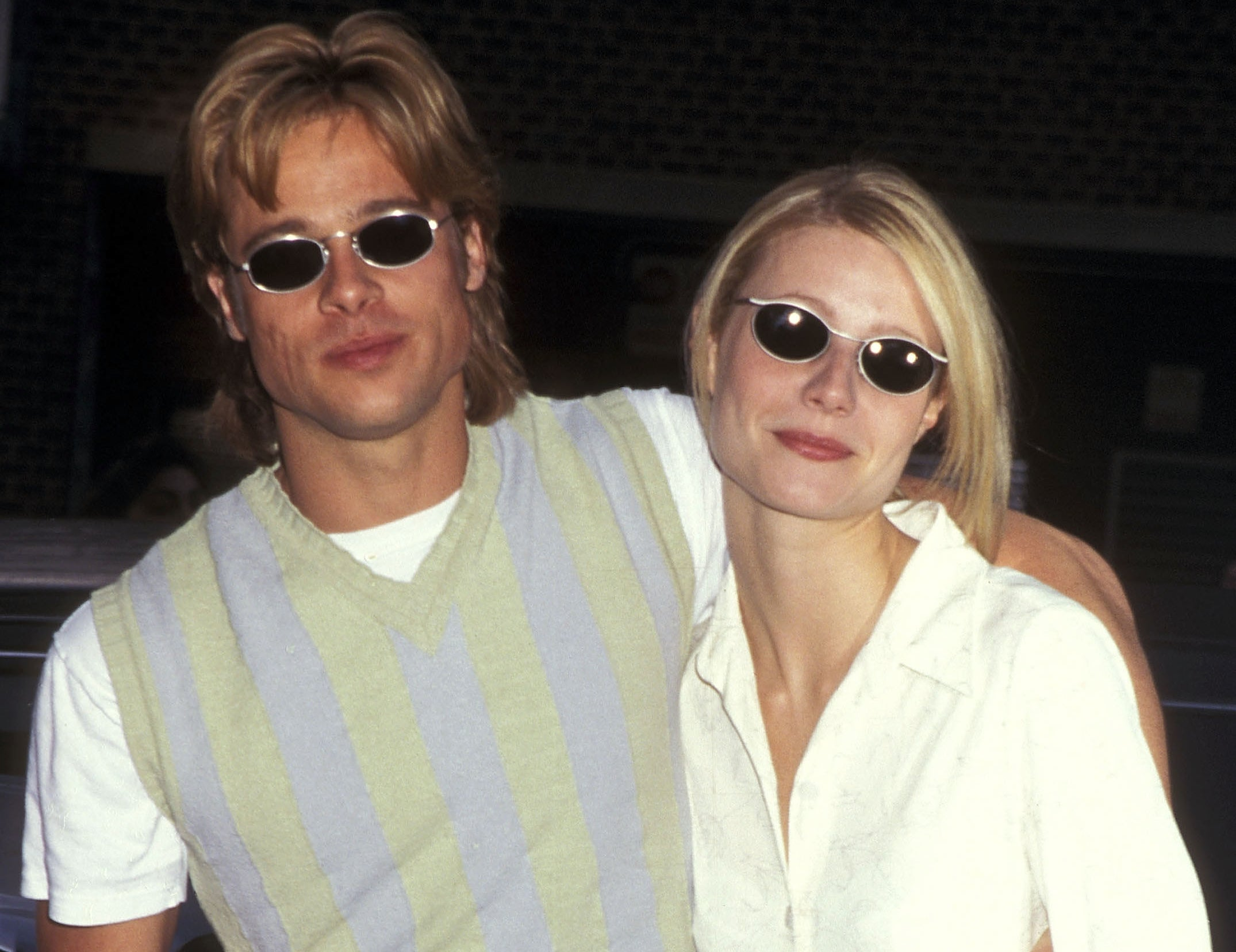 Gwyneth and Brad wear similar oval black sunglasses and pale green tops