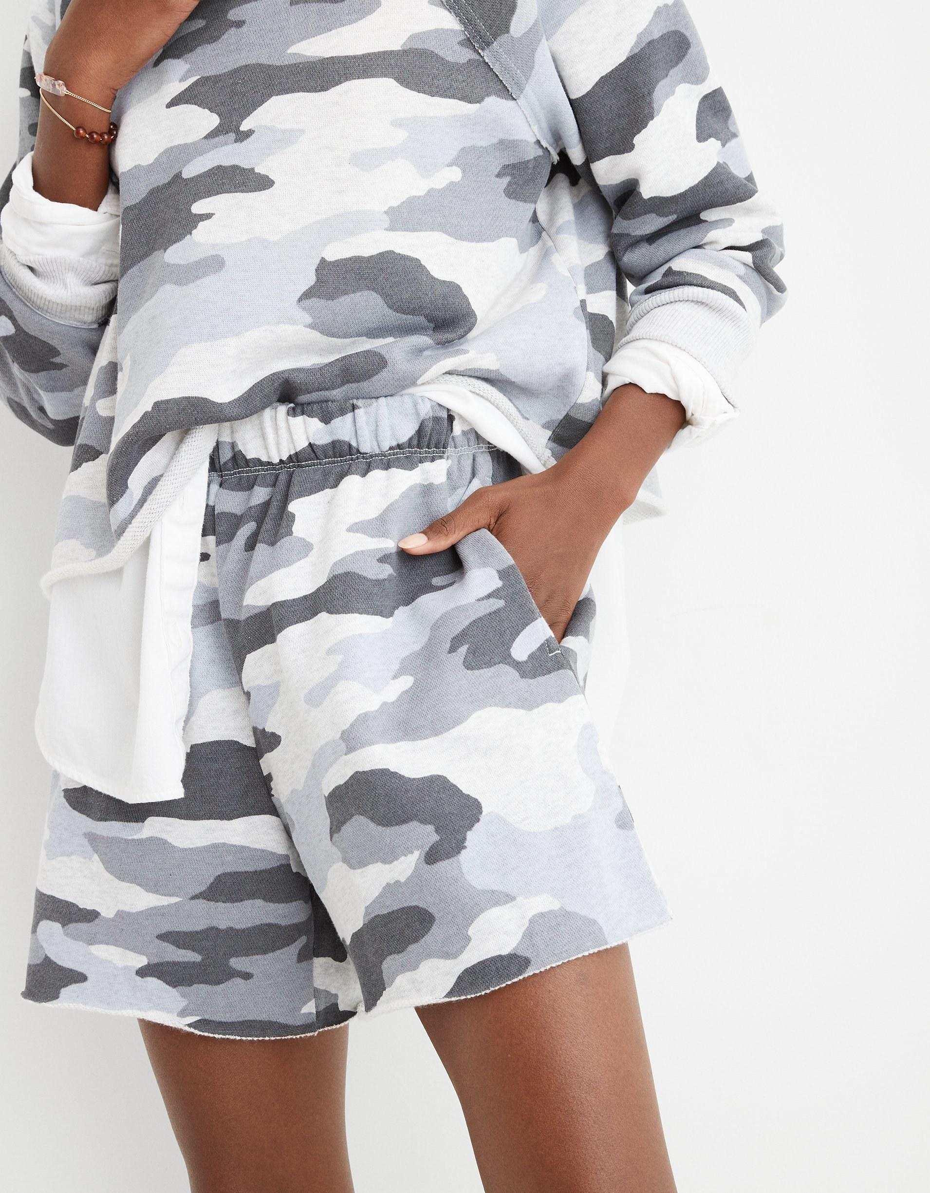 Woman wearing camo shorts