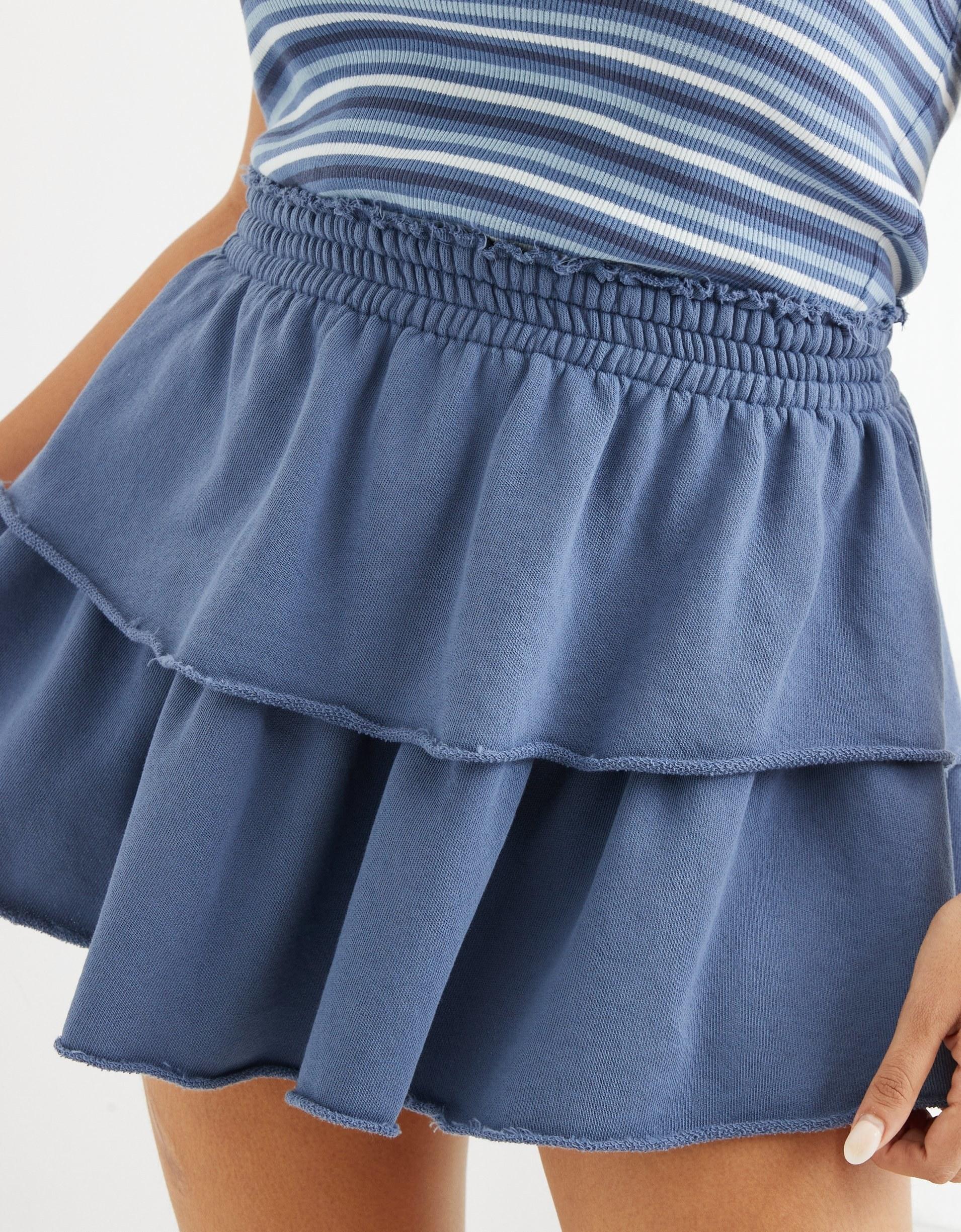 Woman wearing blue skirt
