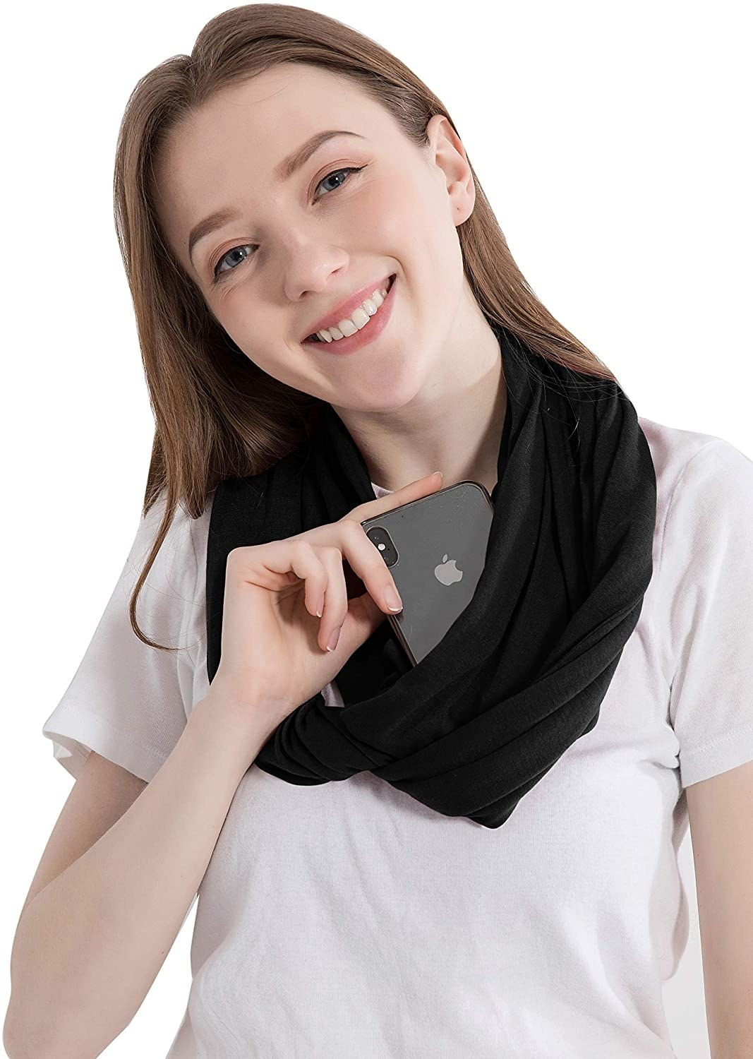a model with the black scarf with a phone half in the pocket
