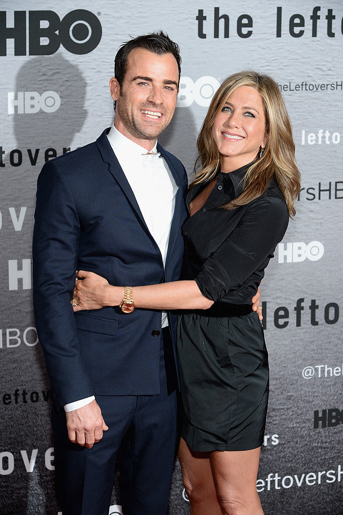 """Justin Theroux (L) and Jennifer Aniston with their arms around each other at """"The Leftovers"""" premiere"""