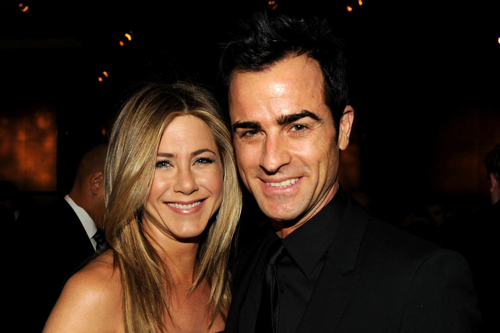 Jennifer Aniston (L) and actor-director Justin Theroux attend the 64th Annual Directors Guild Of America Awards cocktail reception