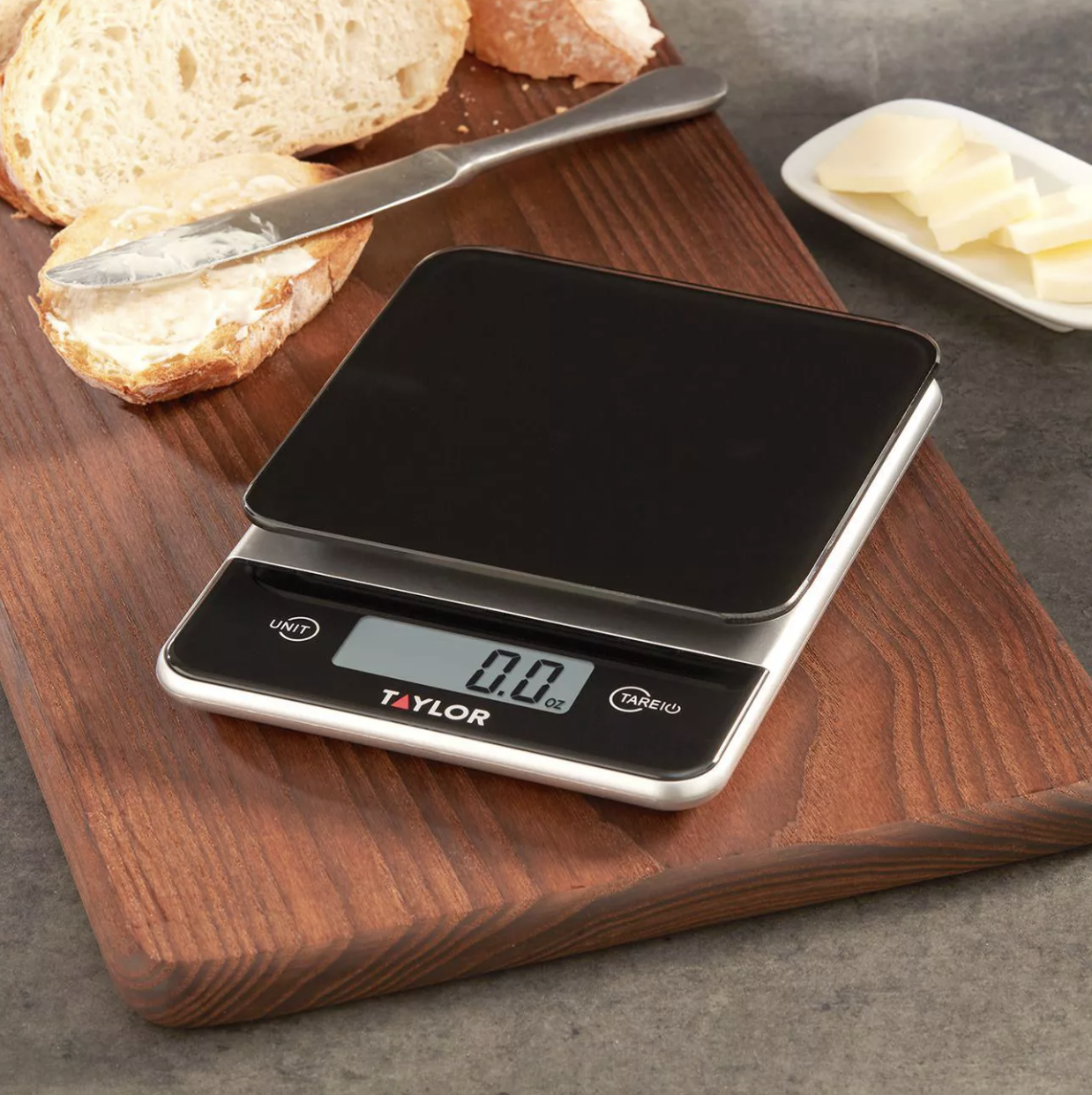 The food scale on top of a cutting board