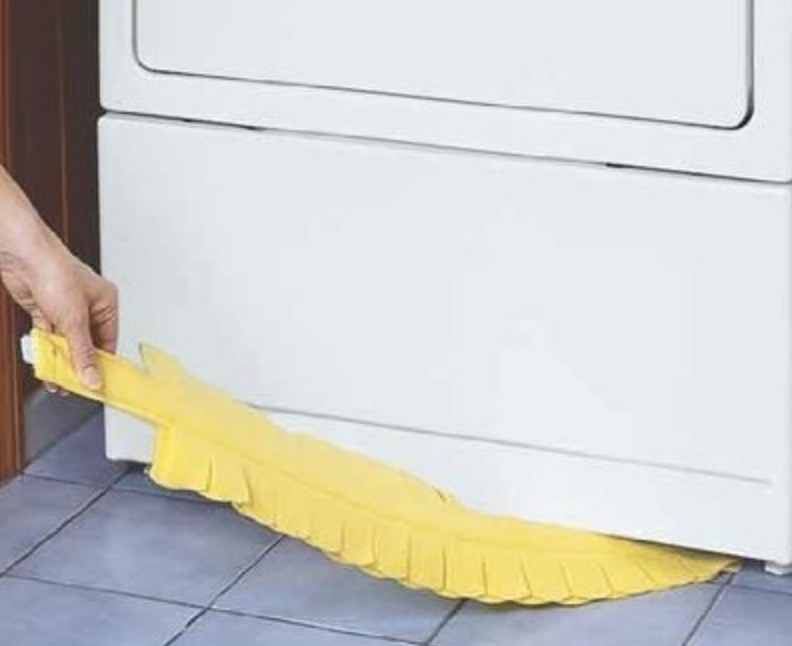 A model using a long, flexible yellow duster to clean under the dryer