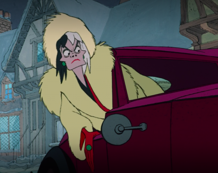 Cruella hangs out her car window to watch the puppies escape