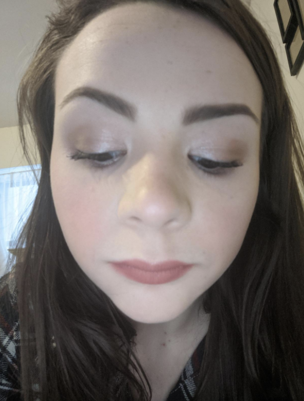 reviewer wearing shimmery eyeshadow shade on eyelids
