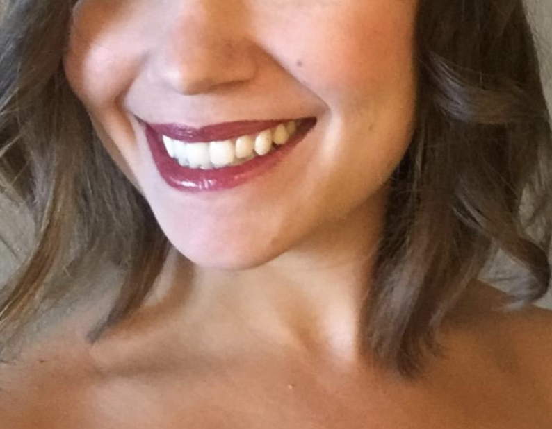 reviewer wearing perfect looking lipstick with a shine to it