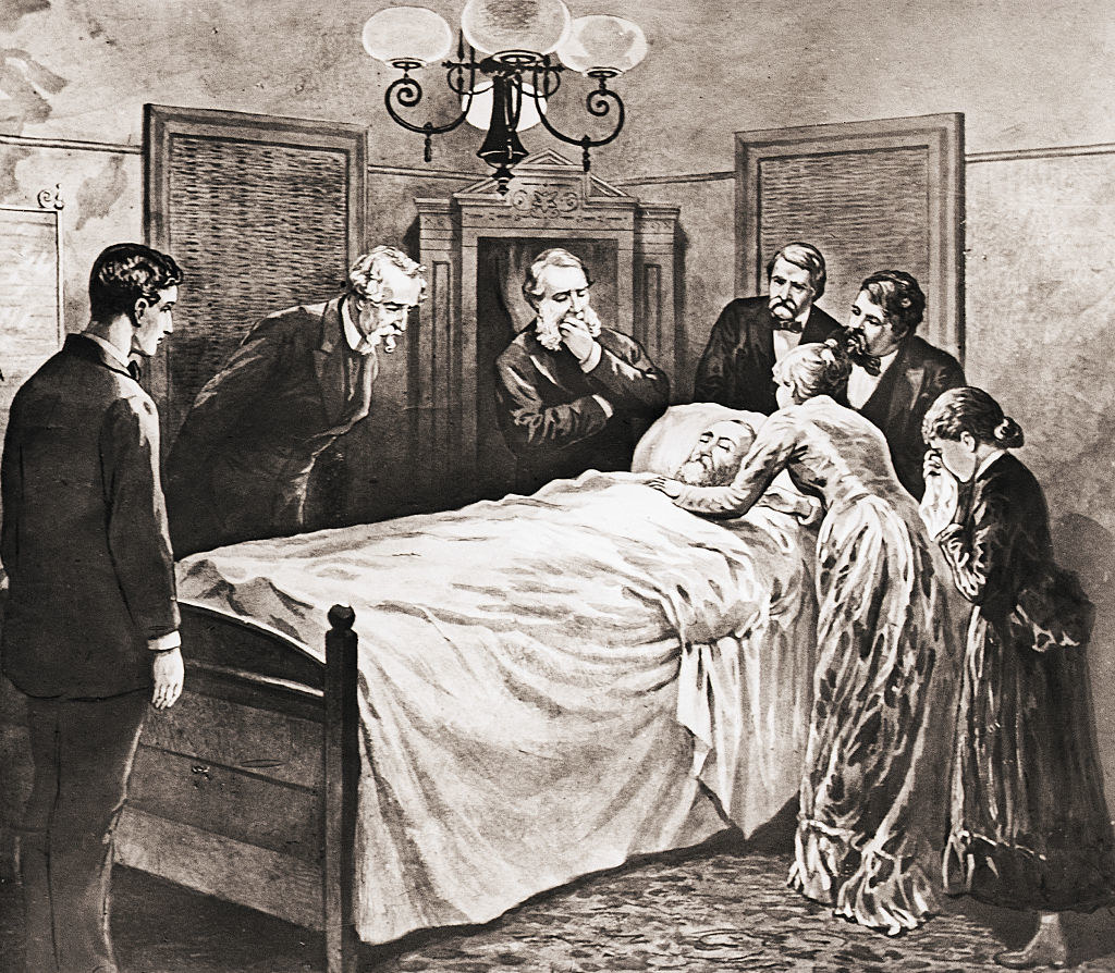 Garfield on his death bed surrounded by doctors and his family