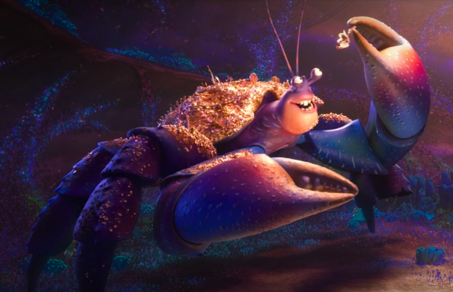 a giant bedazzled hermit crab dangles Moana in the air