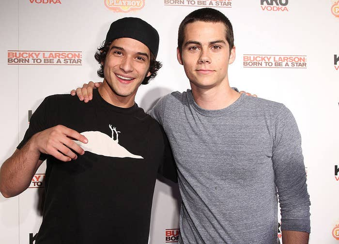 Tyler and Dylan posing on a red carpet together