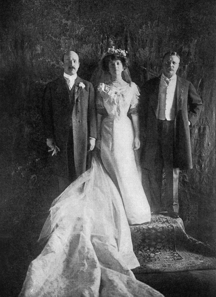 Alice's wedding photos, posing with her father and father in law