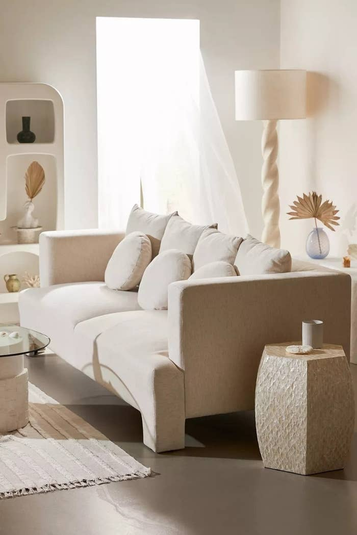 chunky sofa in room white white and beige decor