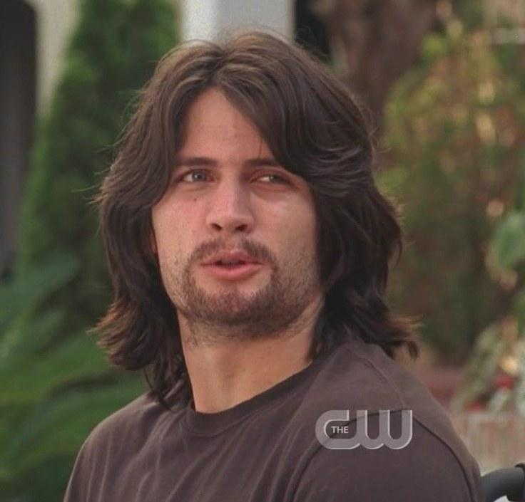 Nathan with shoulder-length wavy hair and beard