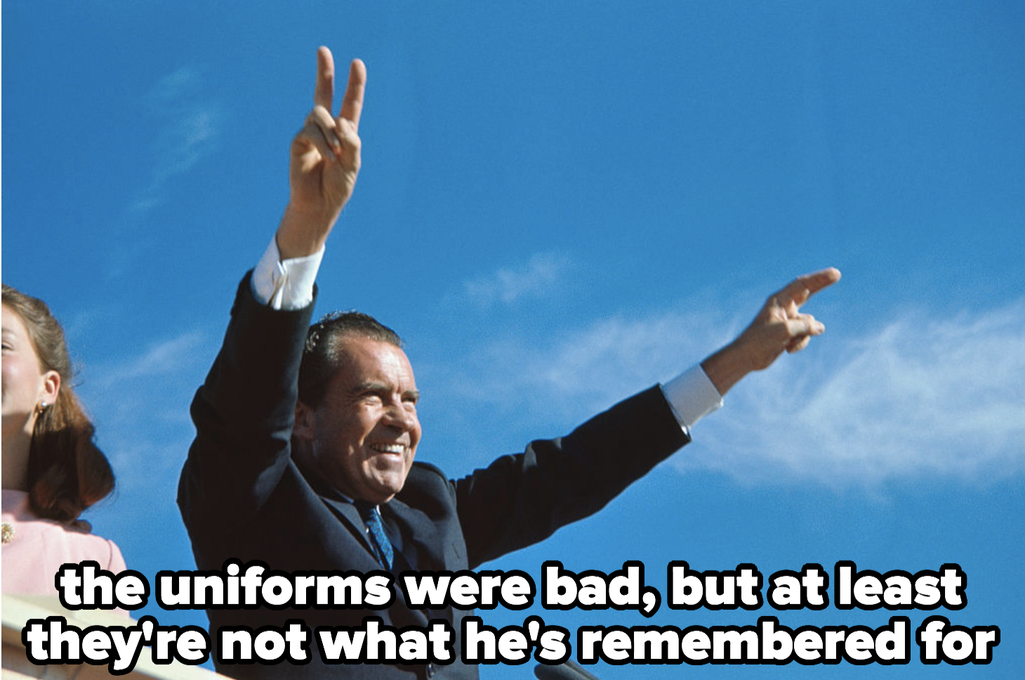 Nixon giving peace signs. The uniforms were bad, but at least they're not what he's remembered for