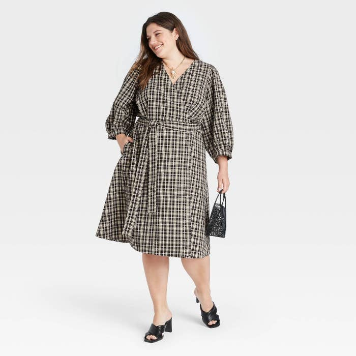 model wearing the plaid puff-sleeve wrap dress