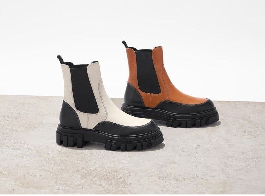 the boots in white and tan with chunky black soles and black accents