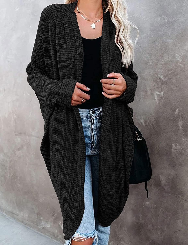 model wearing the black knee length cardigan