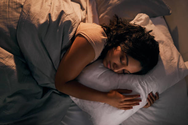 a person sleeping while cradling a pillow