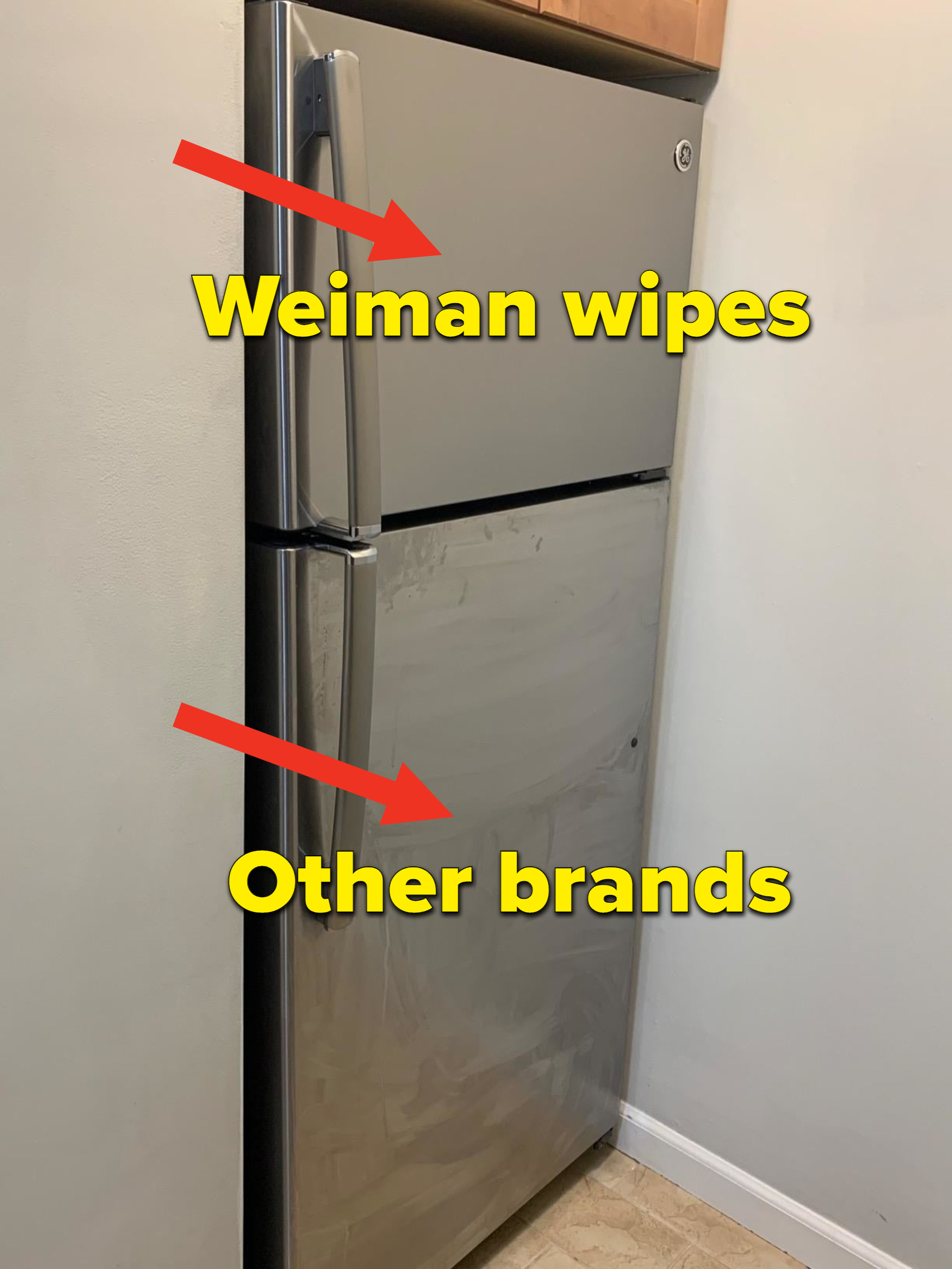 reviewer image of a stainless steel fridge with a clean freezer drawer after using the wipes and a streaky bottom fridge drawer from using a different cleaner