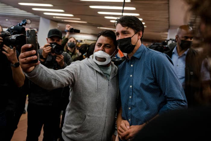 Justin taking a picture with someone during a campaign stop
