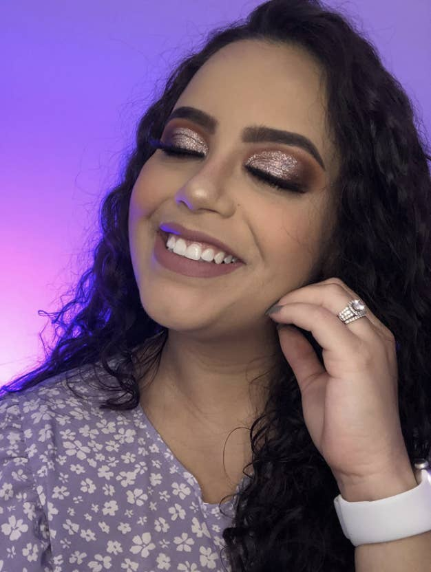 reviewer with super sparkly eye shadow