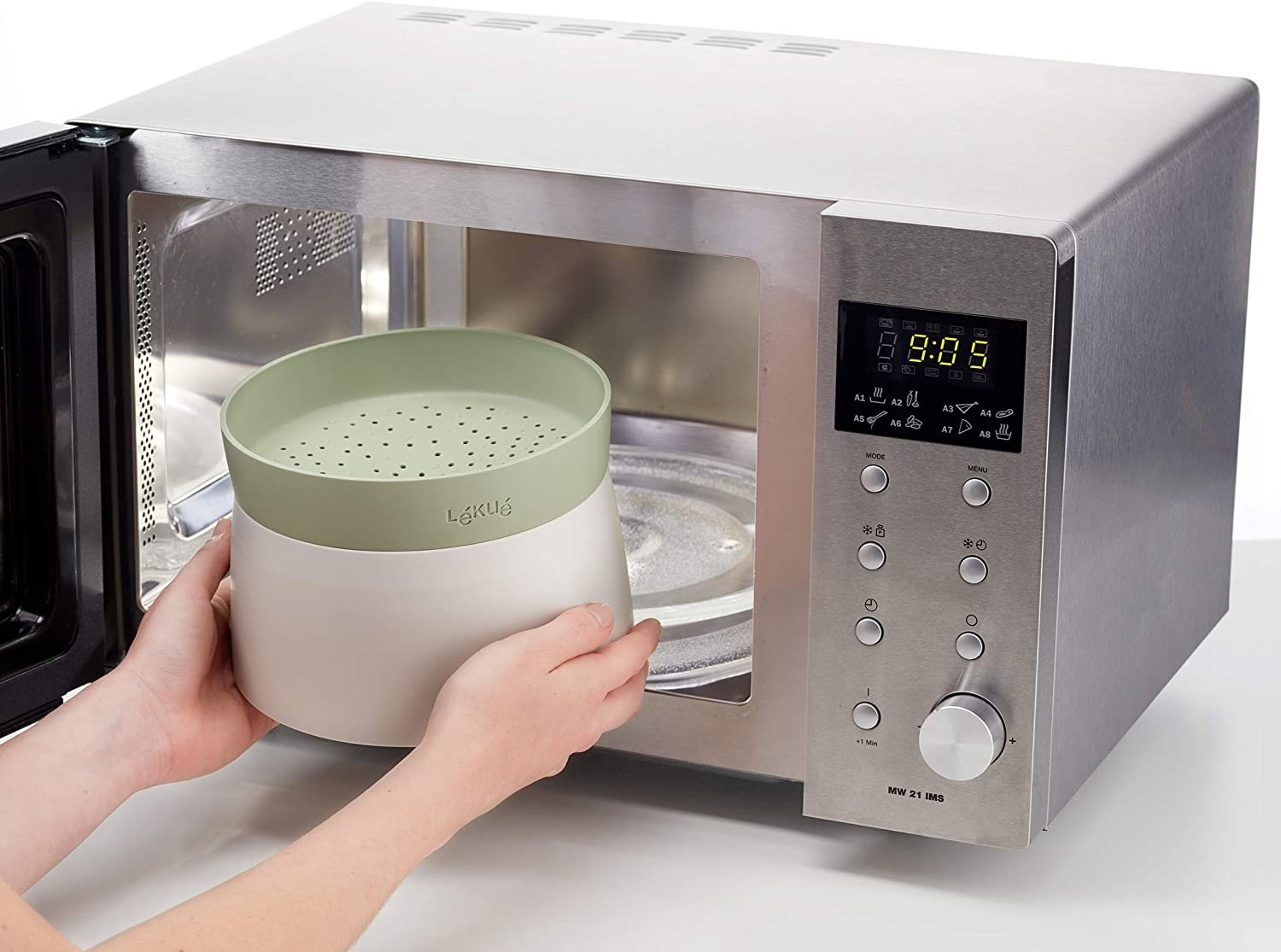 hand putting the green rice cooker into a microwave